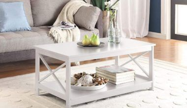 White coffee table with an open storage shelf placed in a bright living room