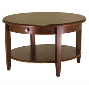 Round coffee table with an antique walnut finish and bottom shelf