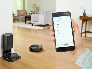 Watching a self emptying robot vacuum while watching smartphone app