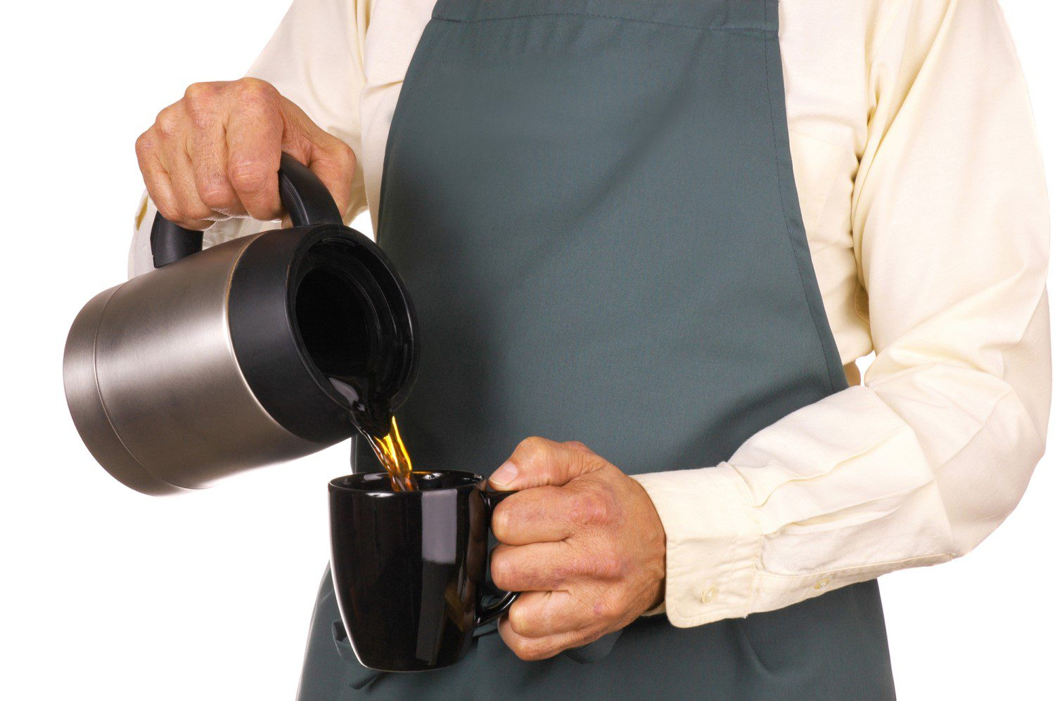 Man pouring a hot cup of coffee from a thermal carafe into a black mug