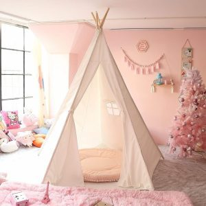 Large white teepee play tent in a pink kids' room