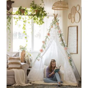 Tiny Land luxury teepee play tent with floral decoration placed inside a kids' room