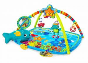 Multi-colored aquatic themed baby play mat with toys and music