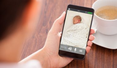 Parent watching baby on a smartphone