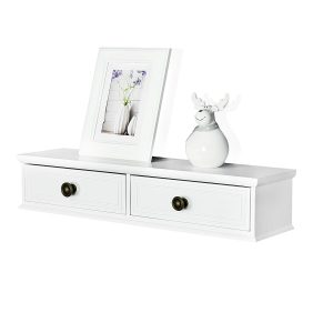 White wooden floating shelf with two drawers at front