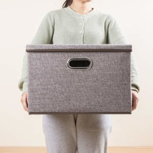 Gray storage box with a lid used for under-bed storage of clothes