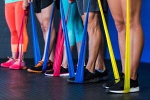 People on a row using resistance bands in multiple colors