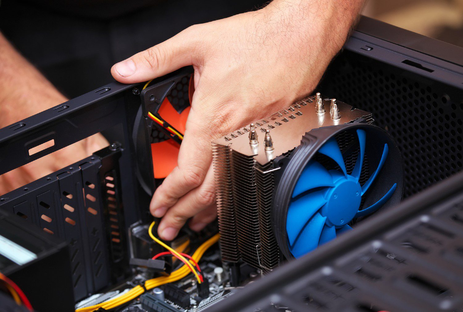 Close-up photo of a person building a PC