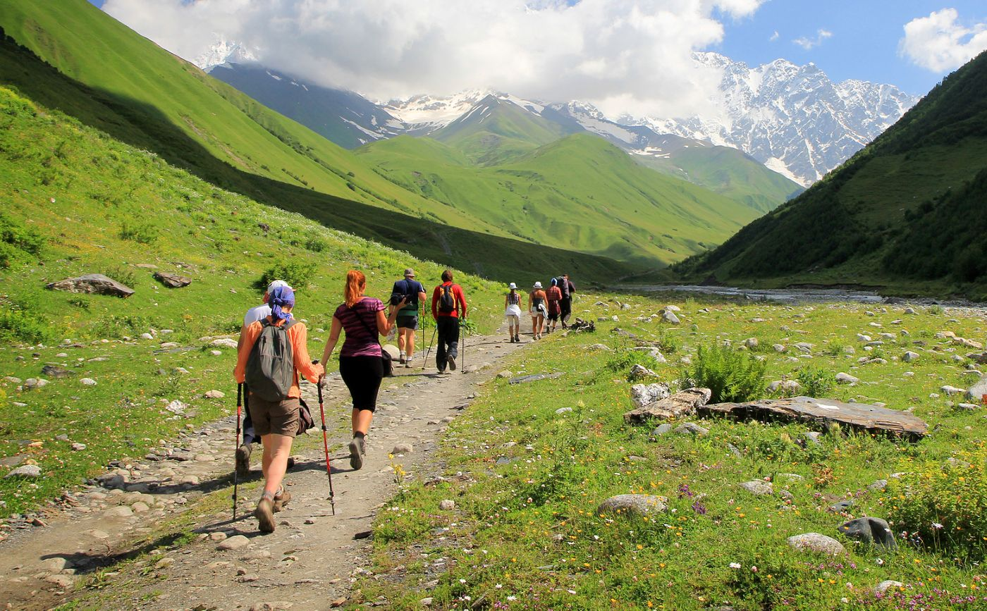 Group of hikers in a mountain valley on a sunny day