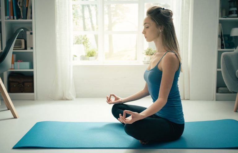 Woman meditating while enjoying the peace