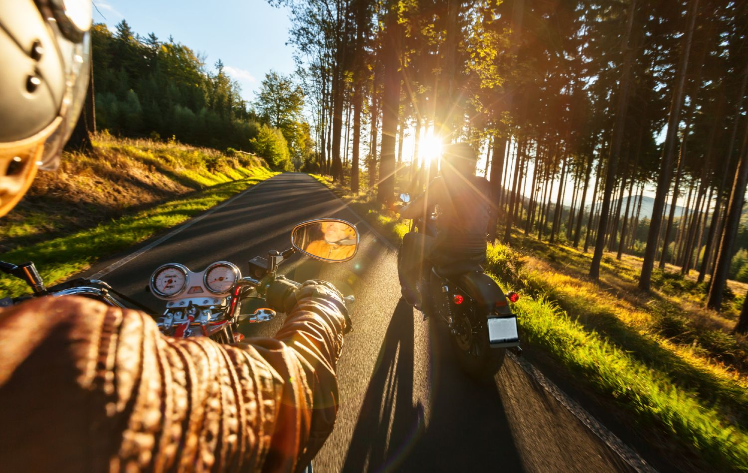 Motorcycle traveling towards the sunset