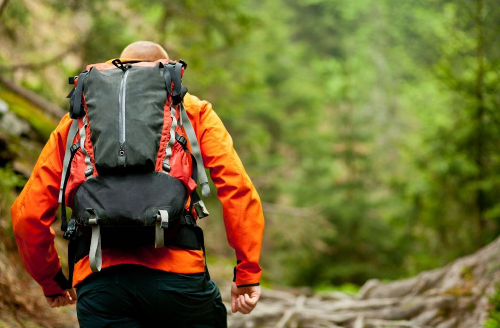Man hiking with a day backpack