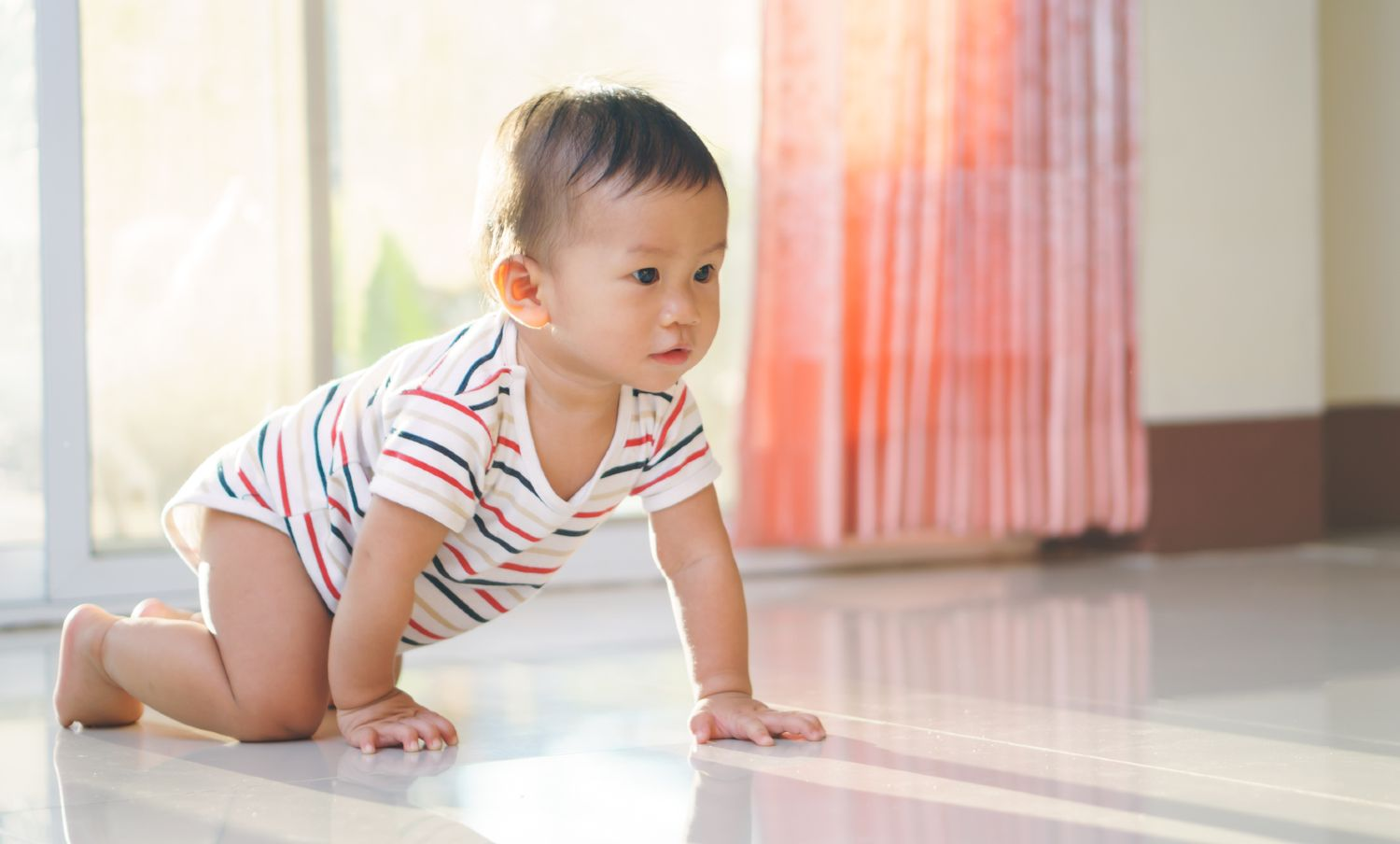 Baby crawling across the floor