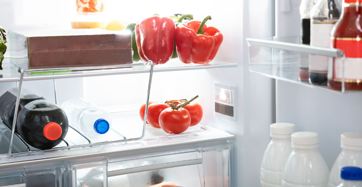 Small open refrigerator with various contents
