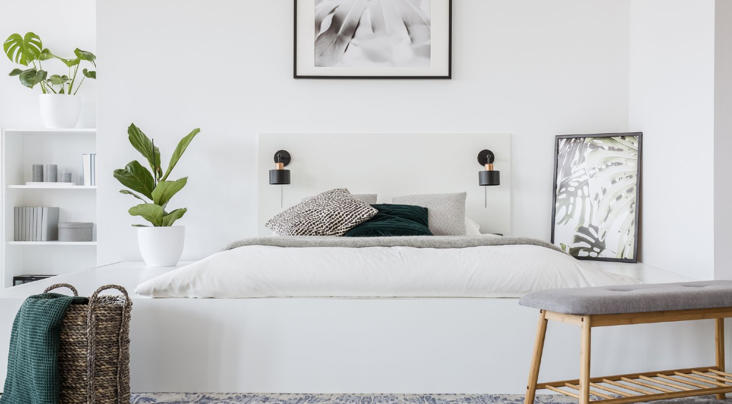 Small bright bedroom neatly organized and clean