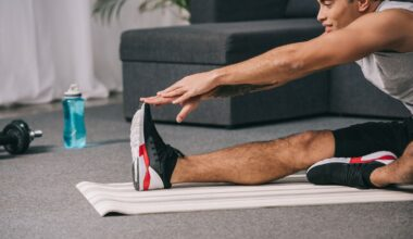 Man stretching out after exercising at home