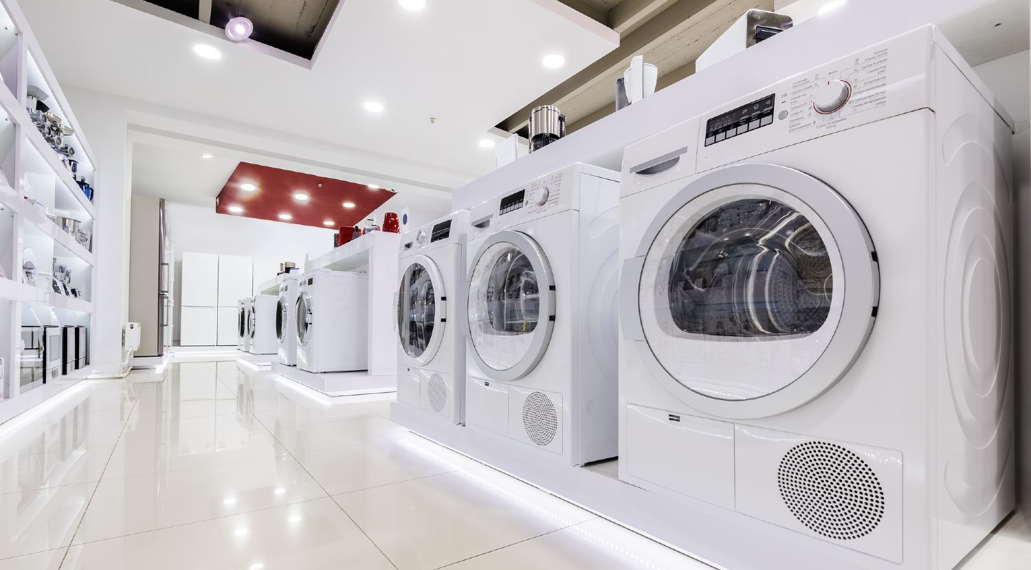 Selection of front load washers on display in a store