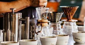 Barista lining up different types of coffee for taste testing