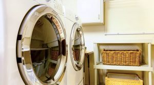 Front-load washer and dryer installed side by side in a small laundry room